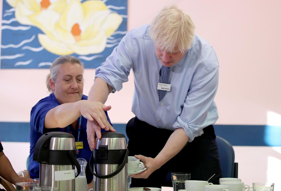 Prime Minister Boris Johnson meets members of staff during a visit to Whipps Cross University Hospital in Leytonstone, east London. (Photo: PA Wire/PA Images)