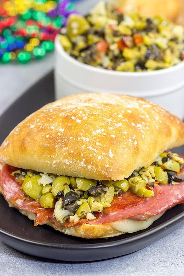 """<p>A fun twist on the classic New Orleans' sandwich, this muffaletta panini is what lunch is all about. Made with ciabatta rolls and stuffed with meat, cheese, and a whole lot of olive spread, these warm sandwiches are as good as it gets.</p> <p><strong>Get the recipe</strong>: <a href=""""https://spicedblog.com/muffaletta-panini.html"""" class=""""link rapid-noclick-resp"""" rel=""""nofollow noopener"""" target=""""_blank"""" data-ylk=""""slk:muffaletta panini"""">muffaletta panini</a></p>"""