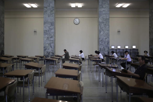 <p>People read at the Grand People's Study House on July 24, 2017, in Pyongyang, North Korea. The building is situated on Kim Il Sung Square and serves as the central library where North Koreans also go to for language classes such as English, Chinese German and Japanese. (Photo: Wong Maye-E/AP) </p>