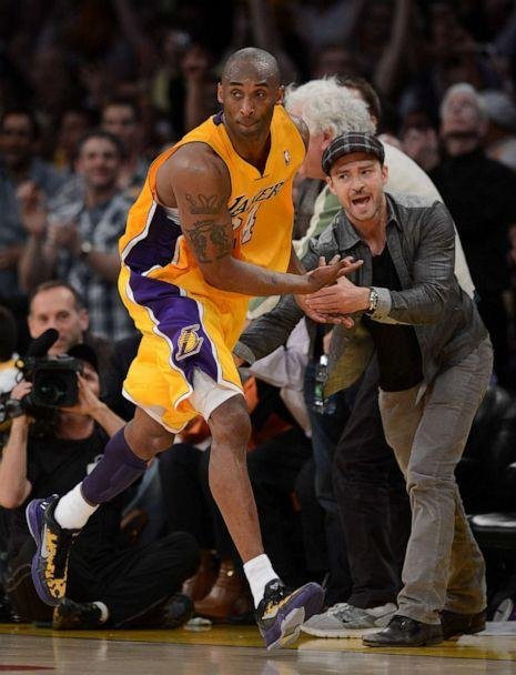 PHOTO: Kobe Bryant of the Los Angeles Lakers reacts with Justin Timberlake after Bryant makes a basket in the fourth quarter against the Denver Nuggets iduring the 2012 NBA Playoffs, May 12, 2012 at Staples Center in Los Angeles. (Harry How/Getty Images)