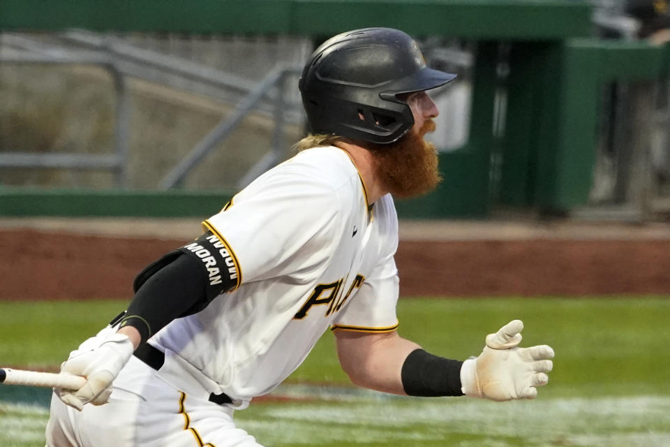 Pittsburgh Pirates' Colin Moran watches his two-run single off Chicago Cubs starting pitcher Zach Davies during the second inning of a baseball game in Pittsburgh, Saturday, April 10, 2021. (AP Photo/Gene J. Puskar)