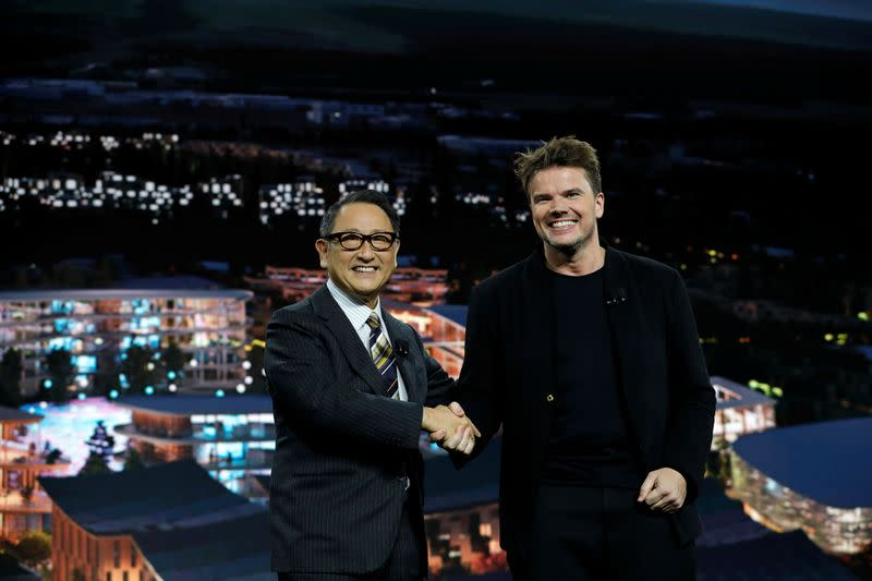 Akio Toyoda, president of Toyota Motor Corporation, and Danish architect Bjarke Ingels, CEO of Bjarke Ingels Group, pose at a news conference during the 2020 CES in Las Vegas