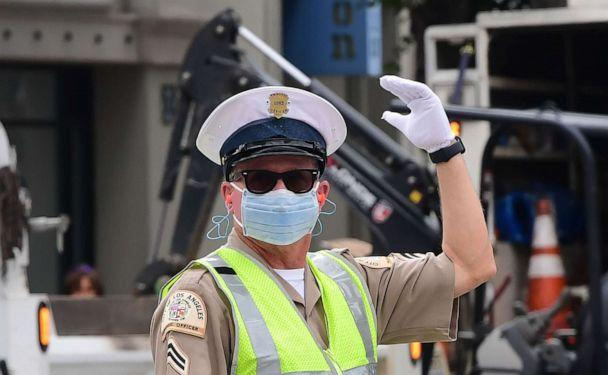 PHOTO: A traffic officer wears a mask as he directs traffic in Los Angeles, California, on March 24, 2020. (Frederic J. Brown/AFP via Getty Images)
