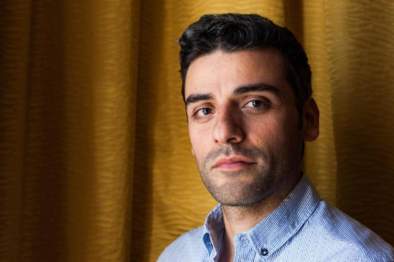 """FILE - In this May 20, 2013 file photo, actor Oscar Isaac poses for portraits at the 66th international film festival, in Cannes, southern France. The cast of """"Star Wars: Episode VII"""" was announced Tuesday, Aril 29, 2014, on the official """"Star Wars"""" website by Lucasfilm. Actors Adam Driver, Max von Sydow, John Boyega, Daisy Ridley, Domhnall Gleeson and Isaac will be joining the cast. (AP Photo/Laurent Emmanuel, File)"""