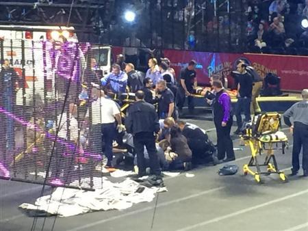 Emergency personnel attend to Ringling Bros. and Barnum & Bailey Circus performers who were injured when the scaffolding they were performing on collapsed in Providence
