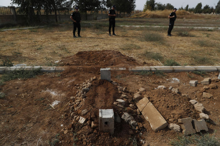 Turkish police officers secure the area of the cemetery where the grave of ten-month-old Mohammed Omar Saar, killed during incoming shelling from Syria Thursday, is following the funeral in Akcakale, Sanliurfa province, southeastern Turkey, at the border with Syria, Oct. 11, 2019. (Photo: Lefteris Pitarakis/AP)