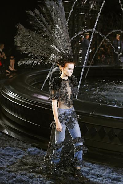 A model presents a creation as part of Vuitton's ready-to-wear Spring/Summer 2014 fashion collection, presented Wednesday, Oct. 2, 2013 in Paris. (AP Photo/Jacques Brinon)