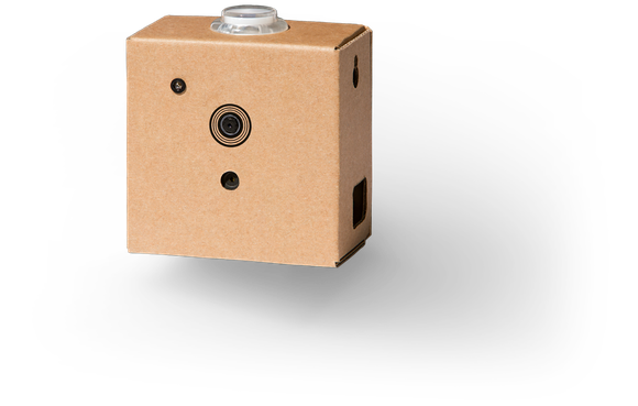 A small cardboard rectangle with a lens on the front that houses the vision kit.