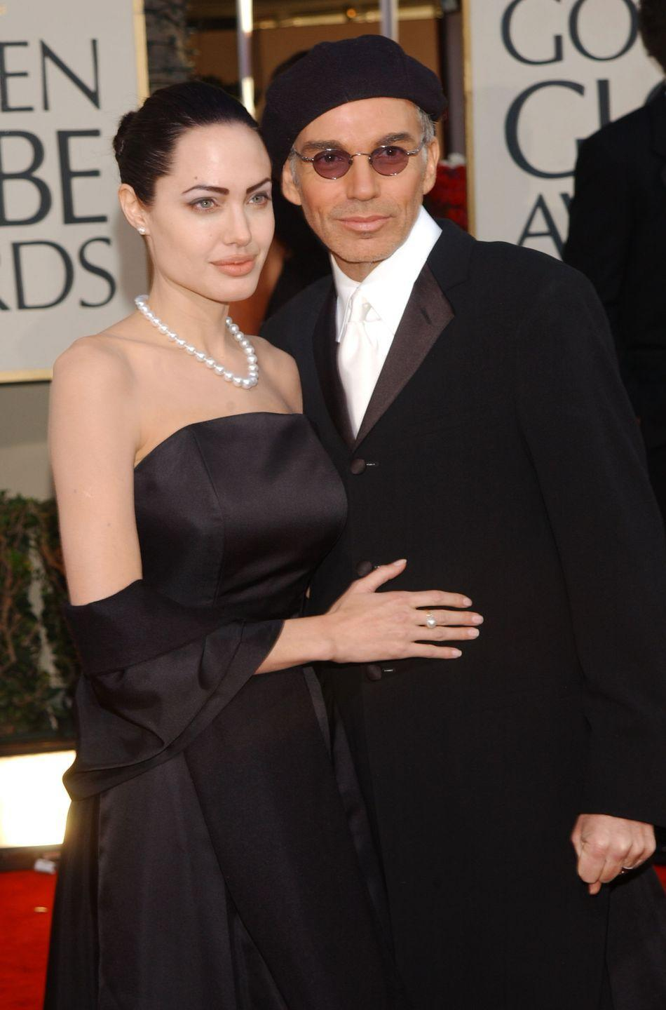 """<p>Years before Brangelina, Angelina was married to Billy Bob from 2000 to 2002. They may have banged in their limo before awards shows and worn necklaces containing each other's blood, but <a href=""""https://people.com/movies/billy-bob-thornton-marriage-angelina-jolie-blood-necklaces/"""" rel=""""nofollow noopener"""" target=""""_blank"""" data-ylk=""""slk:Billy Bob says"""" class=""""link rapid-noclick-resp"""">Billy Bob says</a> the marriage """"wasn't as crazy as people wrote about.""""</p>"""