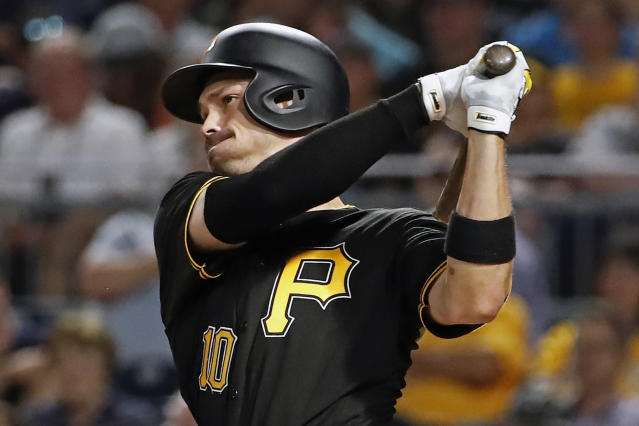 Pittsburgh Pirates' Bryan Reynolds follows through on a three-run home run off Detroit Tigers relief pitcher Nick Ramirez during the sixth inning of a baseball game in Pittsburgh, Wednesday, June 19, 2019. (AP Photo/Gene J. Puskar)