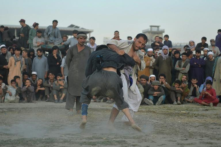 The informal wrestling matches in Kabul attract big partisan crowds, with fans cheering for their favourites -- usually someone from their home district -- and jeering those they want to see lose (AFP/Hoshang Hashimi)