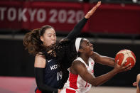 Canada's Laeticia Amihere (15), right, drives to the basket past South Korea's Ji Su Park (19) during women's basketball preliminary round game at the 2020 Summer Olympics, Thursday, July 29, 2021, in Saitama, Japan. (AP Photo/Charlie Neibergall)