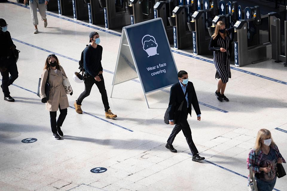 Passengers wearing face masks at Waterloo station in London (Victoria Jones/PA) (PA Archive)