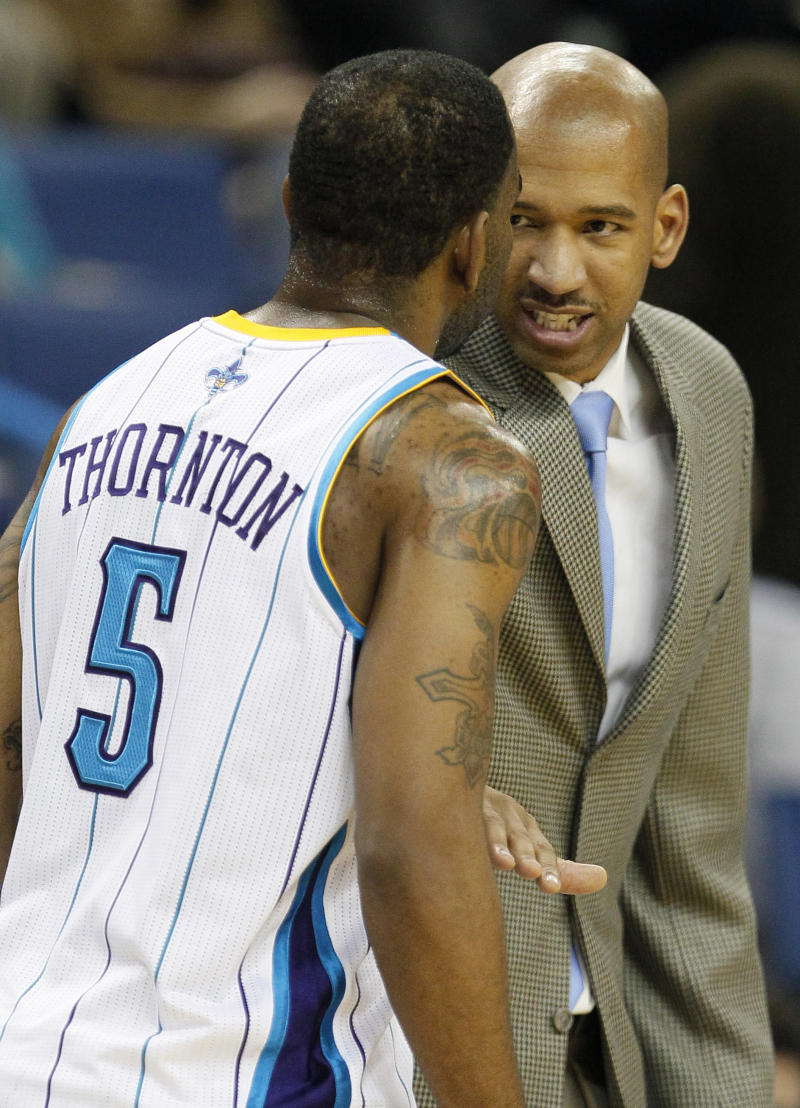 New Orleans Hornets head coach Monty Williams, right, speaks with New Orleans Hornets guard Marcus Thornton in the second half of an NBA basketball game against the Memphis Grizzlies in New Orleans, Wednesday, Jan. 19, 2011. Thornton contributed 17 points to New Orleans' 103-102 overtime win against Memphis. (AP Photo/Patrick Semansky)