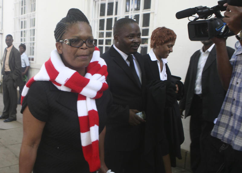 Human rights lawyer Beatrice Mtetwa, left,  leaves the  high court in Harare Monday Monday March 25, 2013. Zimbabwe's High Court  on Monday freed Mtetwa, from eight days of detention on allegations of obstructing the course of justice (AP Photo)