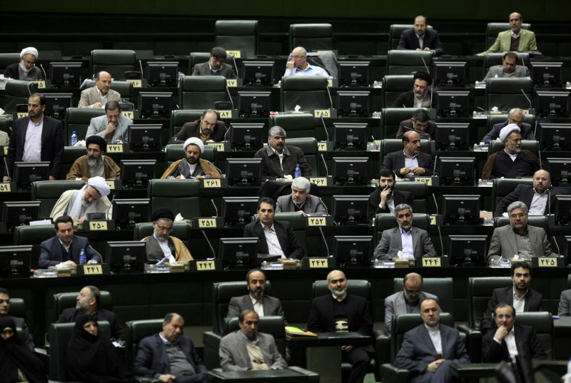 Iranian lawmakers and officials listen to President Mahmoud Ahmadinejad's speech at the parliament in Tehran, Iran, Wednesday, Jan. 16, 2013. Ahmadinejad admitted Wednesday that sanctions have slowed down Iran's growth and disrupted its foreign trade and said the country has to stop relying on oil revenues in state budget to overcome sanctions. (AP Photo/Vahid Salemi)