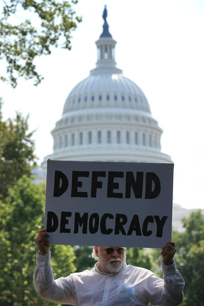 A voting rights activist demonstrates near the U.S. Capitol on Sept. 14.