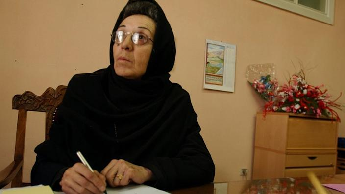 Suhaila Siddiqi works at her desk at the Public Health Ministry building in Kabul, Afghanistan.