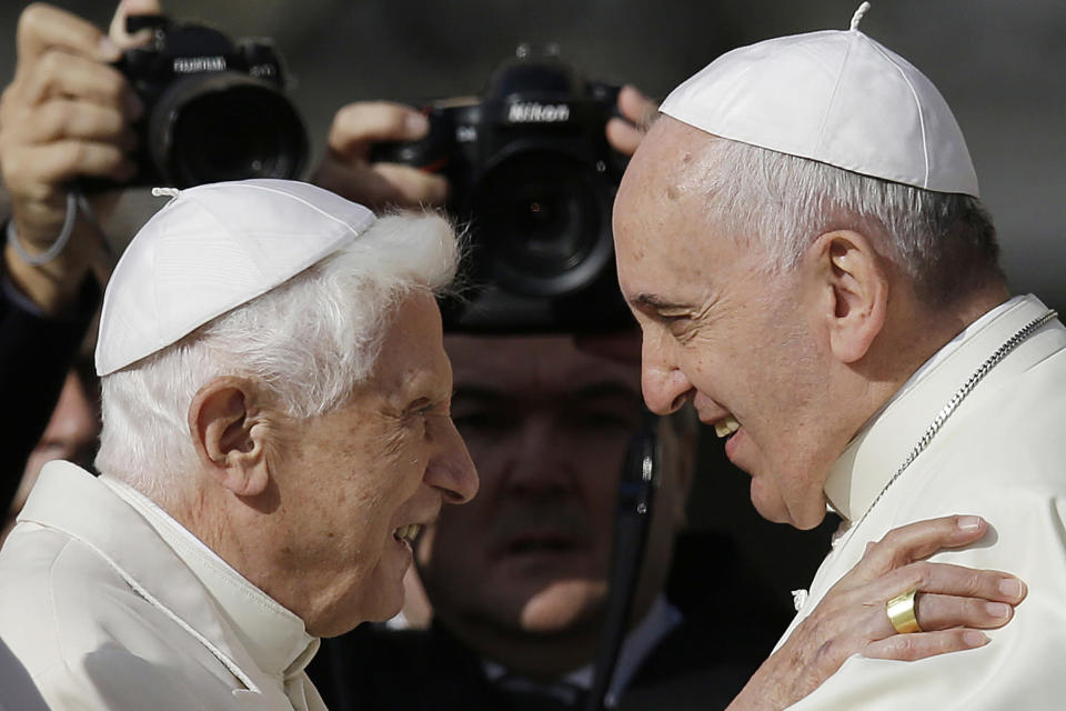 """FILE - In this Sunday, Sept. 28, 2014 file photo, Pope Francis, right, hugs Emeritus Pope Benedict XVI prior to the start of a meeting with elderly faithful in St. Peter's Square at the Vatican. Emeritus Pope Benedict XVI has marked the eighth anniversary of his historic resignation by insisting in an interview published in Corriere della Sera Monday, March 1, 2021, that he stepped down knowingly and that """"there is only one pope"""" _ Francis. (AP Photo/Gregorio Borgia, File)"""