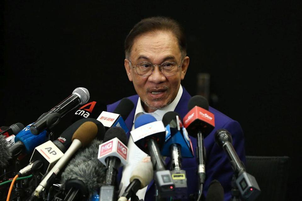 Datuk Seri Anwar Ibrahim said this ratings downgrade was the country's first since the Asian Financial Crisis about 20 years ago. — Picture by Yusof Mat Isa