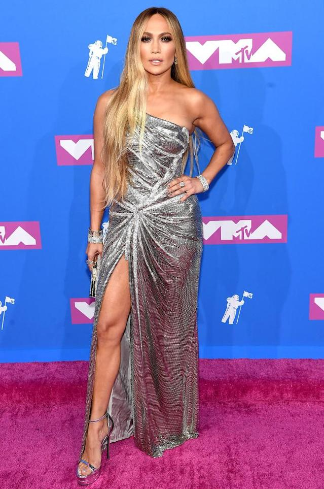 "<p>The recipient of the night's Video Vanguard Award, <a href=""https://www.yahoo.com/lifestyle/jennifer-lopez-shines-like-mtvs-infamous-moon-person-vmas-021310911.html"" data-ylk=""slk:Jennifer Lopez wore a flashy dress;outcm:mb_qualified_link;_E:mb_qualified_link"" class=""link rapid-noclick-resp yahoo-link"">Jennifer Lopez wore a flashy dress</a>, as always, for at least a little while. She changed her wardrobe by the time she hit the stage to perform a medley of her hits. (Photo: Jamie McCarthy/Getty Images) </p>"
