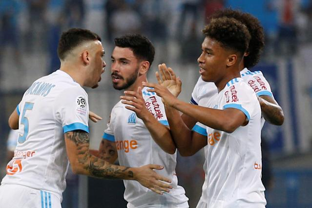 Soccer Football - Ligue 1 - Olympique de Marseille vs Amiens SC - Orange Velodrome, Marseille, France - May 19, 2018 Marseille's Morgan Sanson celebrates scoring their first goal with teammates REUTERS/Philippe Laurenson