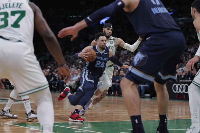 Memphis Grizzlies guard Dillon Brooks (24) drives past Boston Celtics forward Jayson Tatum, rear, during the first half of an NBA basketball game in Boston, Wednesday, Jan. 22, 2020. (AP Photo/Charles Krupa)