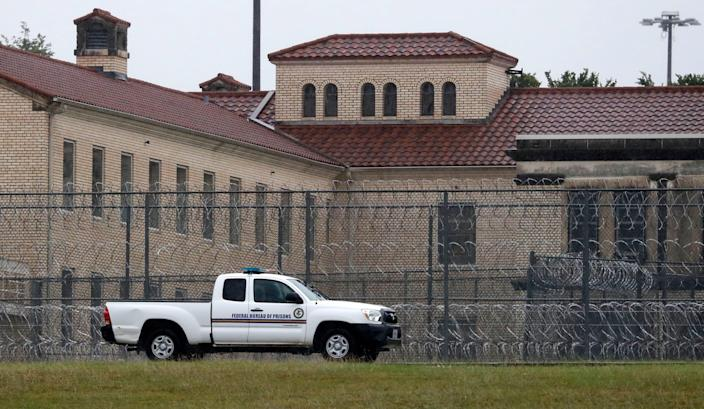 A Federal Bureau of Prisons truck drives past the Federal Medical Center prison in Fort Worth, Texas.