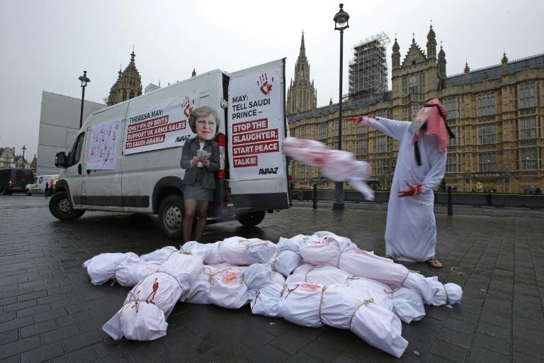 Demonstrators wearing masks depicting Britain's Prime Minister Theresa May and Saudi Arabia's Crown Prince Mohammed bin Salman protested outside the Houses of Parliament