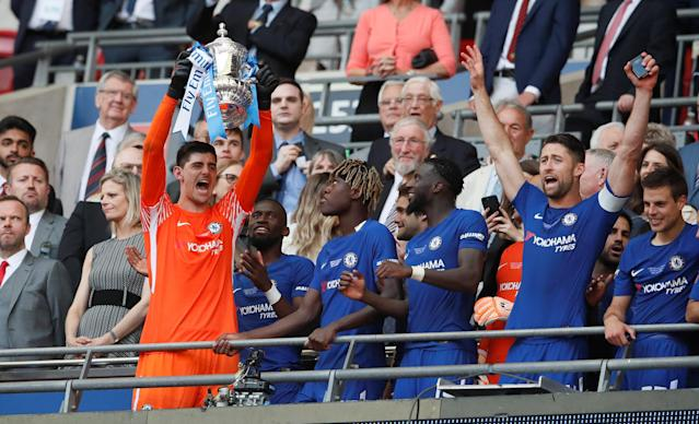 Soccer Football - FA Cup Final - Chelsea vs Manchester United - Wembley Stadium, London, Britain - May 19, 2018 Chelsea's Thibaut Courtois lifts the trophy as they celebrate winning the FA Cup REUTERS/David Klein
