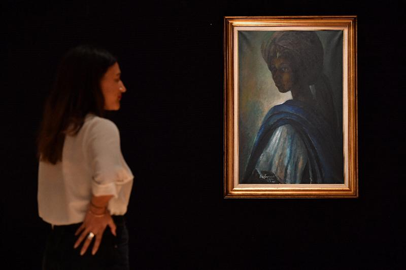 Ben Enwonwu's 1974 painting of the daughter of a Yoruba king has taken on almost mythical status in Nigeria (AFP Photo/BEN STANSALL)