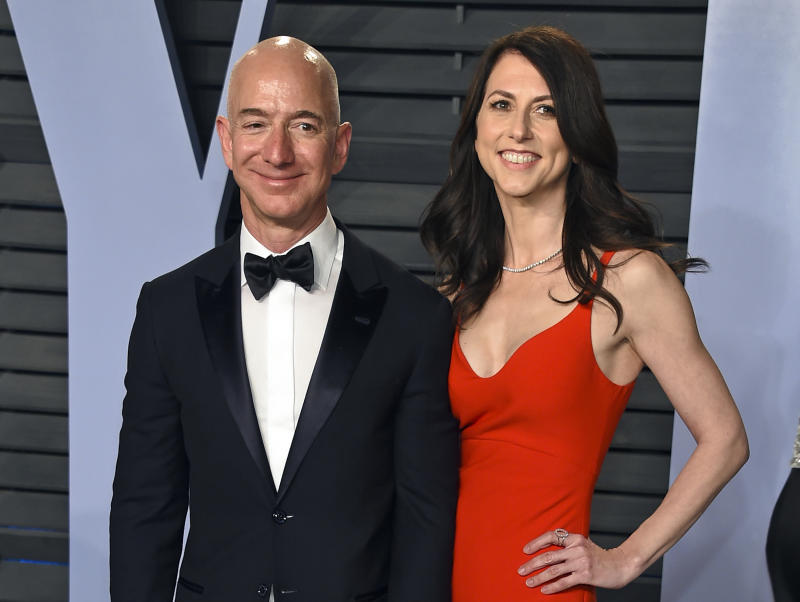 FILE - In this March 4, 2018 file photo, Jeff Bezos and wife MacKenzie Bezos arrive at the Vanity Fair Oscar Party in Beverly Hills, Calif.   Bezos says he and his wife, MacKenzie, have decided to divorce after 25 years of marriage.  Bezos, one of the world's richest men, made the announcement on Twitter Wednesday, Jan. 9, 2019. (Photo by Evan Agostini/Invision/AP, File)