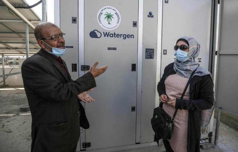 Fathi Sheikh Khalil (L), an engineer with the Palestinian civil society group Damour said the Watergen generators are 'a start' toward tackling a worsening water crisis in the Gaza Strip