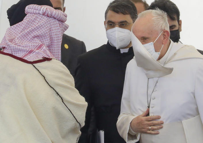 Pope Francis , right, arrives at an interreligious meeting near the archaeological area of the Sumerian city-state of Ur, 20 kilometers south-west of Nasiriyah, Iraq, Saturday, March 6, 2021. Ur is considered the traditional birthplace of Abraham, the prophet common to Muslims, Christians and Jews. Earlier today Francis met privately with the country's revered Shiite leader, Grand Ayatollah Ali al-Sistani. (AP Photo/Andrew Medichini)