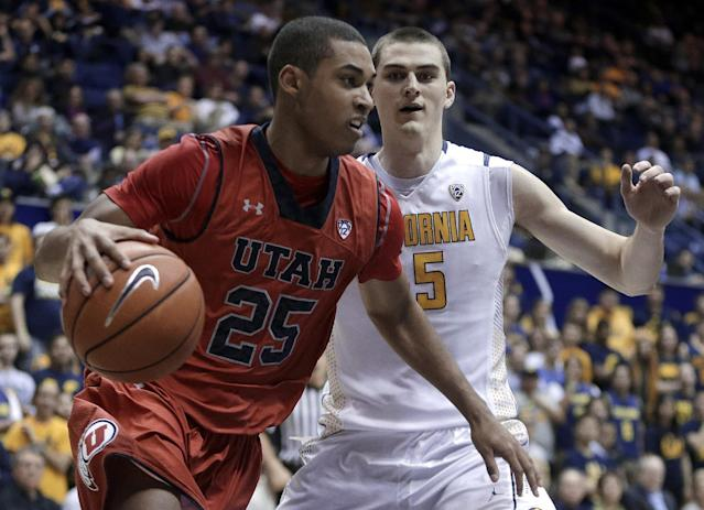 Utah's Kenneth Ogbe, left, drives against California's David Kravish during the first half of an NCAA college basketball game Wednesday, March 5, 2014, in Berkeley, Calif. (AP Photo/Ben Margot)