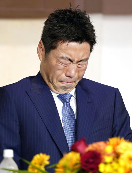 In this May 20, 2019, photo, Japan's Yomiuri Giants pitcher Koji Uehara reacts during a press conference to announce his retirement in Tokyo. Uehara, whose dominant season in relief helped the Boston Red Sox win the 2013 World Series, has retired with Yomiuri Giants, the team that he first played for in Japan. (Katsuya Miyagawa/Kyodo News via AP)