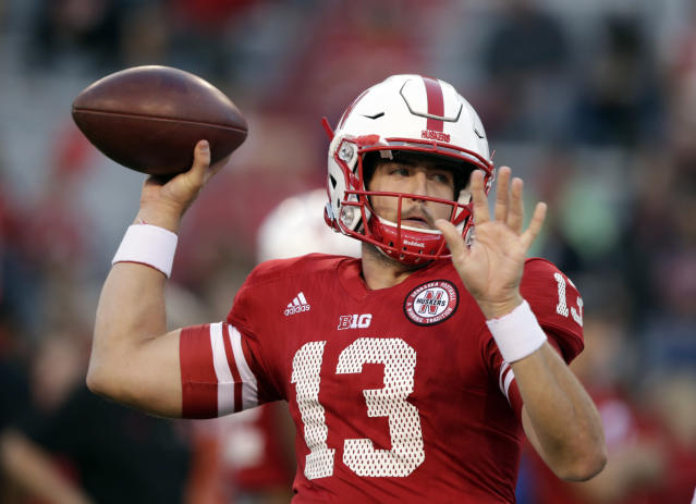 "Nebraska quarterback <a class=""link rapid-noclick-resp"" href=""/ncaaf/players/241199/"" data-ylk=""slk:Tanner Lee"">Tanner Lee</a> (13) warms up before an NCAA college football game against Wisconsin in Lincoln, Neb., Saturday, Oct. 7, 2017. (AP Photo/Nati Harnik)"