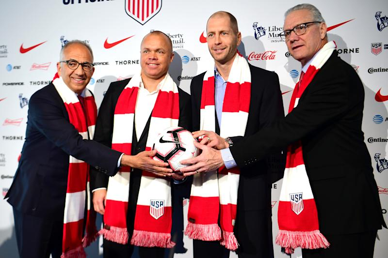 Carlos Cordeiro (left) and Earnie Stewart (second from left) spoke during and after Friday's U.S. Soccer board meeting. Jay Berhalter, brother of Gregg Berhalter (second from right), was once considered a top candidate to replace Dan Flynn (right) as CEO. (Sarah Stier/Getty Images)