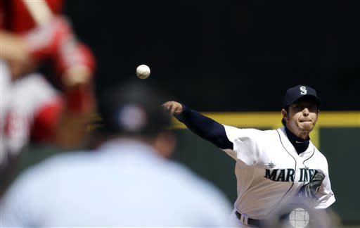 Seattle Mariners starting pitcher Hisashi Iwakuma throws against the Los Angeles Angels in the third inning of a baseball game on Sunday, April 28, 2013, in Seattle, Wash. (AP Photo/Elaine Thompson)