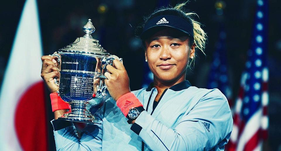 Naomi Osaka shows off her US Open trophy
