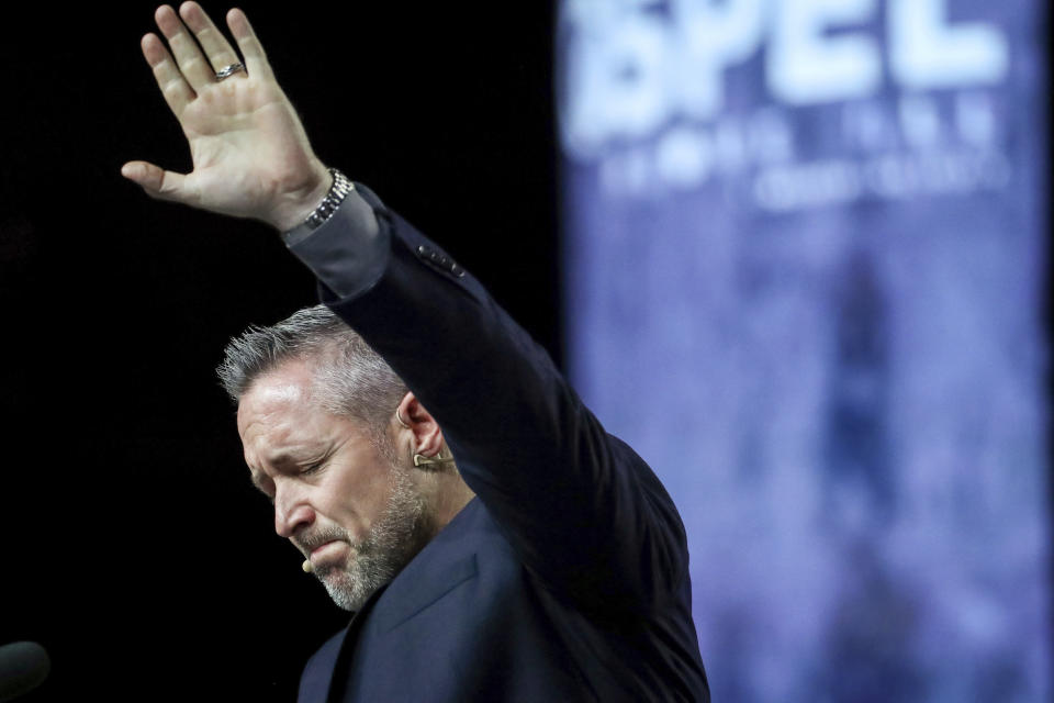 FILE - In this Wednesday, June 12, 2019 file photo, J. D. Greear, president of the Southern Baptist Convention, talks about sexual abuse within the SBC on the second day of the SBC's annual meeting in Birmingham, Ala. On March 30, 2021, Greear posted a photo on Facebook of him getting the COVID-19 vaccine. It drew more than 1,100 comments — many of them voicing admiration, and many others assailing him. (Jon Shapley/Houston Chronicle via AP)