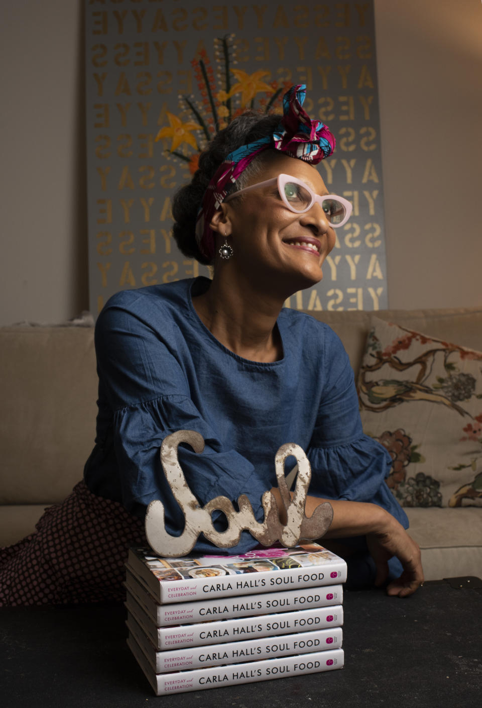 Carla Hall in New York City, 2018, with a stack of her books. (Photo: Marvin Joseph/The Washington Post via Getty Images)