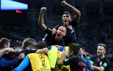 Croatia players celebrate euphorically after the final whistle - Credit: REUTERS/Ivan Alvarado