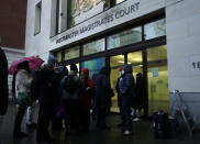 """Julian Assange supporters mixed with members of the media queue up outside Westminster Magistrates Court to get a seat at his Bail hearing in London, Wednesday, Jan. 6, 2021. On Monday, Judge Vanessa Baraitser ruled that Julian Assange cannot be extradited to the US. because of concerns about his mental health. Assange had been charged under the US's 1917 Espionage Act for """"unlawfully obtaining and disclosing classified documents related to the national defence"""". Assange remains in custody, the US. has 14 day to appeal against the ruling. (AP Photo/Matt Dunham)"""