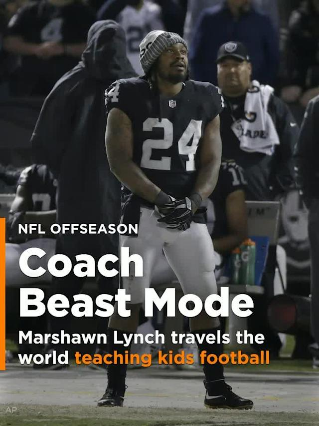 Marshawn Lynch's new offseason hobby seems to be traveling the world and teach American football to kids.