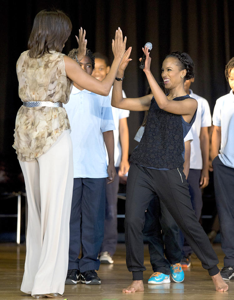 Actress Kerry Washington got a high-five from the first lady when she and Michelle Obama paid a visit to Savoy Elementary School in Washington, D.C., on Friday. The school was one of eight selected last year for the Turnaround Arts Initiative at the President's Committee on the Arts and Humanities, a program that uses the arts to help improve low performing schools (5/24/2013)