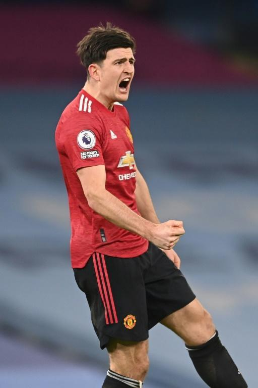 Derby delight: Harry Maguire celebrates Manchester United's 2-0 win over Manchester City