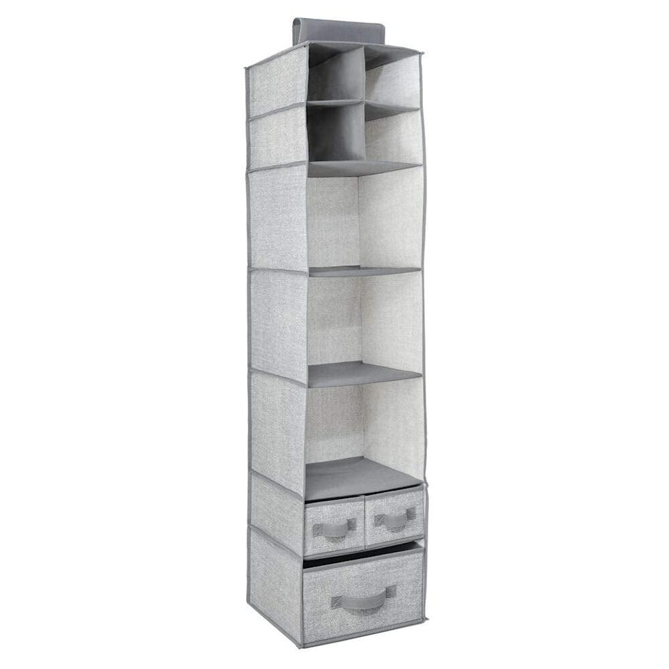 """<p>The <a href=""""https://www.popsugar.com/buy/MDesign%20Hanging%20Storage%20Organizer-465749?p_name=MDesign%20Hanging%20Storage%20Organizer&retailer=amazon.com&price=20&evar1=casa%3Auk&evar9=46355519&evar98=https%3A%2F%2Fwww.popsugar.com%2Fhome%2Fphoto-gallery%2F46355519%2Fimage%2F46355533%2FMDesign-Hanging-Storage-Organizer&list1=college%2Corganization%2Cclosets%2Csmall%20spaces%2Ccloset%20organization%2Csmall%20space%20living%2Cdorms&prop13=api&pdata=1"""" rel=""""nofollow noopener"""" target=""""_blank"""" data-ylk=""""slk:MDesign Hanging Storage Organizer"""" class=""""link rapid-noclick-resp"""">MDesign Hanging Storage Organizer</a> ($20, originally $22) offers seven open compartments and three removable drawers, so big or small, you'll find room for all of your things that need storage.</p>"""