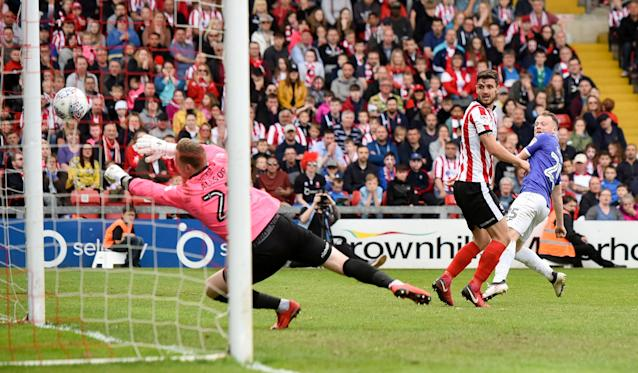 "Soccer Football - League Two Play Off Semi Final First Leg - Lincoln City v Exeter City - Sincil Bank, Lincoln, Britain - May 12, 2018 Exeter City's Jake Taylor has his shot saved by Lincoln City's Ryan Allsop Action Images/Paul Burrows EDITORIAL USE ONLY. No use with unauthorized audio, video, data, fixture lists, club/league logos or ""live"" services. Online in-match use limited to 75 images, no video emulation. No use in betting, games or single club/league/player publications. Please contact your account representative for further details."