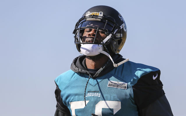 FILE - In this Jan. 19, 2018, file photo, Jacksonville Jaguars defensive end Dante Fowler (56) runs a drill during NFL football practice in Jacksonville, Fla. Fowler and cornerback Jalen Ramsey are back from suspension. But neither player is talking about what got them banned for a week or how they spent their time away. They were not available during an open locker room session Monday, Aug. 20, 2018. The team says both players will answer questions following Jacksonville's preseason game against the Atlanta Falcons on Saturday night. (AP Photo/Gary McCullough, File)